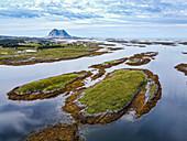 Aerial of the rugged coastline of the UNESCO World Heritage Site, the Vega Archipelago, Norway, Scandinavia, Europe