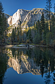 High granite cliffs reflected in the tranquil Merced River, autumn, Yosemite Village, Yosemite National Park, UNESCO World Heritage Site, California, United States of America, North America