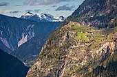 High mountain farms in the Ötztal near Umhausen, view towards the Inn Valley, Tyrol, Austria