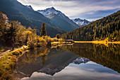 Small mountain lake in Lüsenstal, St. Sigmund im Sellrain, Stubai Alps, Tyrol, Austria