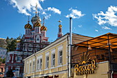 Sign of supermarket with the colorful domes of the Church of the Nativity of the Blessed Virgin Mary (Stroganov Church) behind it, Nizhny Novgorod, Nizhny Novgorod District, Russia, Europe