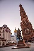 Kazan Shalyapin Palace Hotel and the statue of Shalyapin in Baumana Street with bell tower of Epiphany Church, Kazan, Kazan District, Republic of Tatarstan, Russia, Europe