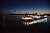 River cruise ship Semyon Budyonny on Volga River at night, Kazan, Kazan District, Republic of Tatarstan, Russia, Europe