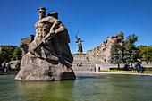 Statues in pond with fountain below the steps to the huge Motherland Ruf statue, Volgograd, Volgograd District, Russia, Europe
