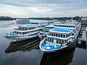 Aerial view of river cruise ships docked along Volga River, Uglich, Yaroslavl District, Russia, Europe