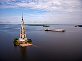 Aerial view of the river cruise ship Excellence Katharina (formerly MS General Lavrinenkov) while passing the Kalyazin bell tower in the Volga river (which is all that is left of the old town of Kalyazin after the Uglich reservoir was flooded), Kalyazin, Tver district, Russia, Europe