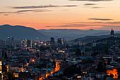 View of Sarajevo cityscape against mountain range