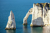 Close-up of the Porte d'Aval (elephant trunk) arch and the Aiguille rock needle on the Alabaster Coast near Étretat, Normandy, France.