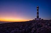 The lighthouse from Cap d'Artrutx at sunset, Ciutadella. Menorca, Balearic Islands, Spain, Europe