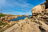 Rocky landscape on the Cote de Granit Rose in the foreground, Brittany, France, Europe