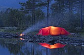 Red tent, campfire, Sefrivatnet, Tosfjellet, Nordland, Norway