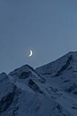 Evening mood with crescent moon, Hohe Tauern, Salzburg, Austria
