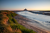 Morning view of the rocky island of Mont Saint Michel with the monastery of the same name, Normandy, France.