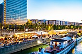 France, Paris, the banks of the Seine, the port of the Gare, ephemeral restaurant terrace during the summer with the François Mitterrand Library