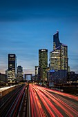 France, Hauts de Seine, La Defense, on the right the Tour First, by the architects Pierre Dufau, Jean-Pierre Dacbert, Michel Stenzel, David Serero, and the Tower CB21 by the architect John Wieser, traffic on the N13 and the Pont de Neuilly