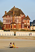 France, Somme, Baie de Somme, Le Crotoy, Belle-Epoque villa and beach cabines along Jules-Noiret promenade