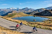 France, Savoie, Saint Jean de Maurienne, the largest bike trail in the world was created within a radius of 50 km around the city under the Iron Cross Pass, view of cyclists and Lake Laitelet and the needles of Arves