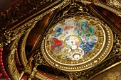 France, Paris, Garnier Opera house (1878) under the architect Charles garnier, the cupola of the ceiling of the great hall painted by Marc Chagall and the great chandelier
