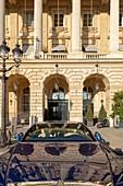 France, Paris, facade of the Crillon Hotel Place de la Concorde and luxury car
