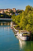 France, Rhone, Lyon, historical site listed as World Heritage by UNESCO, dock De Serbie with a view of the bridge Winston Churchill and the Croix Rousse, Rhone River banks