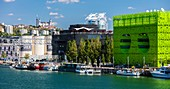 France, Rhone, Lyon, district of La Confluence in the south of the peninsula, first French quarter certified sustainable by the WWF, view of the quai Rambaud along the old docks with the Green Cube, the Ycone tower, the Sucriere and Notre Dame de Fourviere Basilica