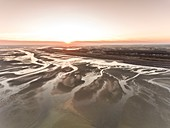 France, Somme, Baie de Somme, La Mollière d'Aval, flight over the Baie de Somme near Cayeux sur Mer, here the shoreline consists of the pebble cord that extends to the cliffs of Ault and at low tide the sandbanks extend to view