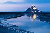 France, Manche, Mont Saint Michel Bay listed as World Heritage by UNESCO, Abbey of Mont Saint Michel and River Couesnon, by night