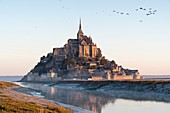 France, Manche, Mont Saint Michel Bay listed as World Heritage by UNESCO, Abbey of Mont Saint Michel and River Couesnon