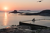 France, Ille et Vilaine, Saint Malo, Bon Secours Beach, diving board and sea water pool at sunset