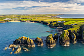 Aerial vista of Merope Rocks, Padstow Lifeboat Station and Mother Ivey's Bay, Cornwall, England, United Kingdom, Europe