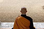 Zen Buddhist master practising Zazen (meditation) in Orval Trappist Abbey's Zen garden, Belgium, Europe