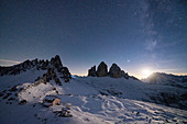 Monte Paterno, Tre Cime di Lavaredo and Rifugio Locatelli hut lit by moon, Sesto Dolomites, South Tyrol, Italy, Europe