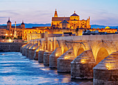 View over Roman Bridge of Cordoba and Guadalquivir River towards the Mosque Cathedral, dusk, UNESCO World Heritage Site, Cordoba, Andalusia, Spain, Europe