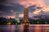 Sun and Moon pagodas at sunset in Guilin, Guilin, Guangxi, China, Asia