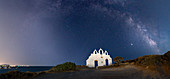 Milky Way arches above Agios Georgios on Paros Island, Cyclades, Greek Islands, Greece, Europe