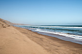 High sand dunes of the Namib Desert meet the ocean, Sandwich Harbour, Namibia, Africa