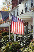 American flag hanging in front of Suburban House