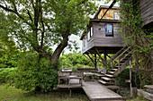 View of stilt hut and garden