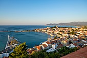Greece, Samos island, Pythagoreion built on the remains of a former fortified town, a UNESCO World Heritage site, the harbour at sunrise dominated by Lykourgos Logothetis castle and Transfiguration (or Metamorphosis) church