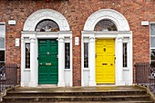 Ireland, Dublin, Merrion Square, the famous colorful doors and their brass knobs and handles typically from Georgian art