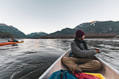 Canada, British Columbia, Man fishing from canoe in Squamish River