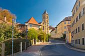 Germany, Bavaria, Bamberg, Empty street with church tower