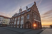 Poland,West Pomerania,Kamien Pomorski,Historic town hall at dusk