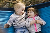 Two little girls (2-3) in hammock in Uinta-Wasatch-Cache National Forest