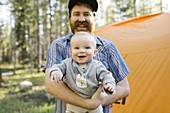 Portrait of happy father with baby son (6-11 months) in Uinta-Wasatch-Cache National Forest