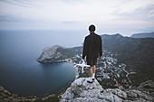 Italy,Liguria,La Spezia,Man at mountain top holding drone