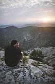 Italy,Liguria,La Spezia,Man at mountain top photographing mountain range