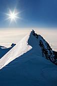 Switzerland,Monte Rosa,Sun shining over Monte Rosa Massif