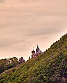 View over the Siebengebirge to Drachenburg Castle, Koenigswinter, North Rhine-Westphalia, Germany
