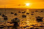 Boats in Brittany in the golden evening light at low tide, Brittany, France, Europe